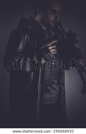 Secret, portrait of murderer with gun - stock photo