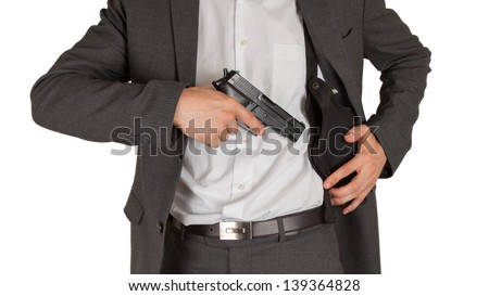 Secret service agent with a gun, isolated on white - stock photo