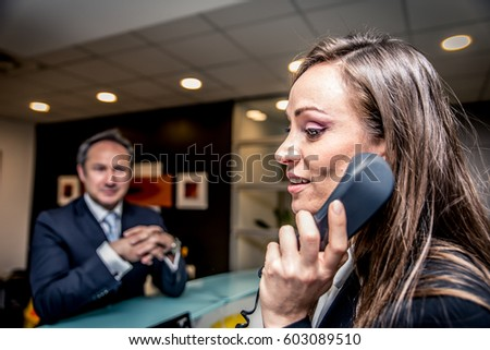 Secretary answering the phone in an office