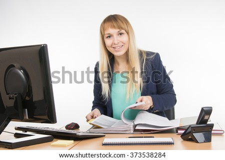 Secretary leafing through papers in a big folder and looked into the frame