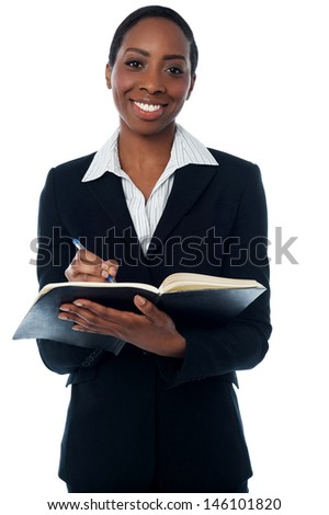 Secretary making a list of appointments - stock photo