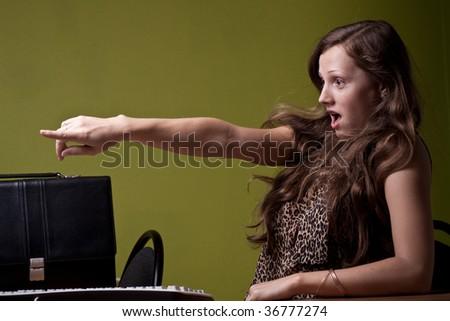 Secretary pointing left - stock photo