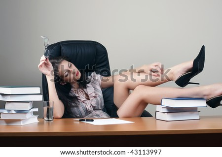 secretary  sit at the table in an armchair