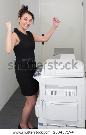 secretary using a copy machine - stock photo