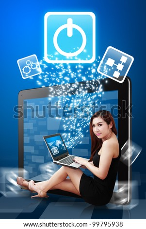 Secretary using notebook computer and Power icon from tablet PC - stock photo