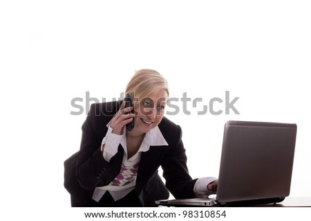 Secretary with phone and laptop - stock photo