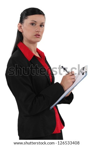 secretary writing on clipboard - stock photo