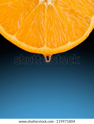 Section of a juicy orange with a drop of juice - stock photo