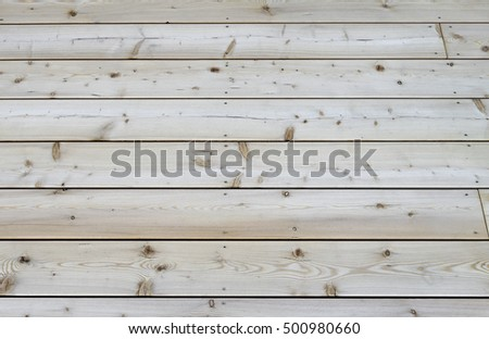 Section of a new  rustic terrace floor,  built of pine tree planks.