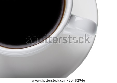 Section of a white cup and saucer with black coffee. - stock photo