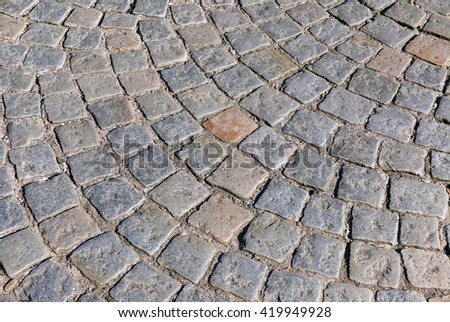 Section of cobbled stones in circular pattern