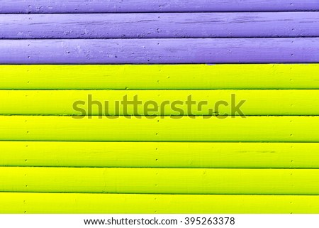 Section of purple and lime green wood panelling from a seaside beach hut. Perfect as a background for Summer Holiday or seaside themes.
