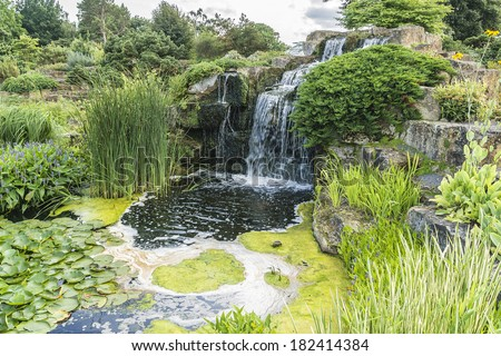 Section of the rock garden with waterfall in Kew botanical garden. Richmond, London, UK - stock photo