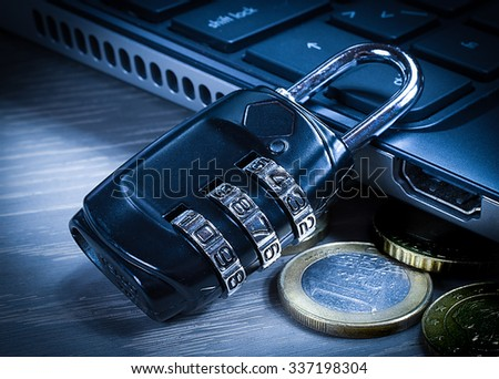 Secure internet connection: lock, money coins, computer - stock photo