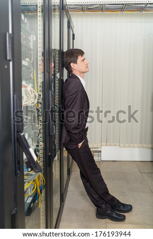 Secure network technician engineer in server room - stock photo