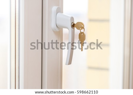 Secure window handle with key in closeup