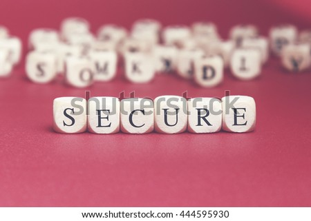 Secure word written on wood cube with red background