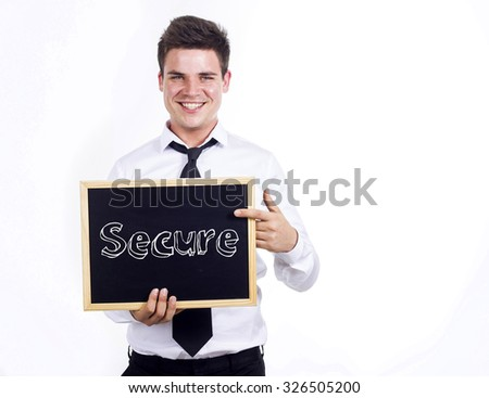 Secure - Young smiling businessman holding chalkboard with text