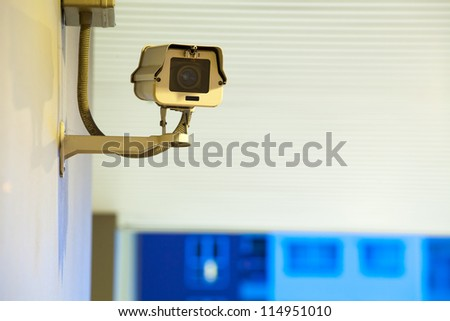 Security Camera, CCTV on location at night - stock photo