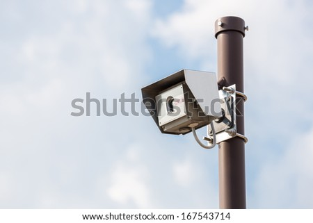 Security Camera CCTV with blue sky - stock photo