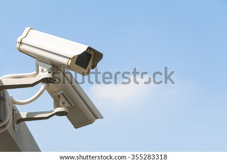 Security camera detects the movement on sky background watch right - stock photo