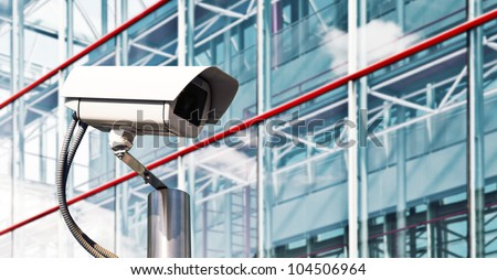 Security Camera in a Modern Building - stock photo