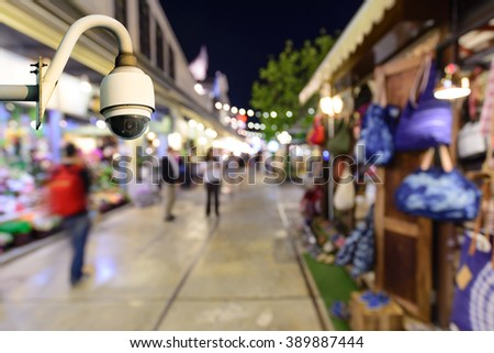 Security camera monitoring events in shopping center at night. - stock photo