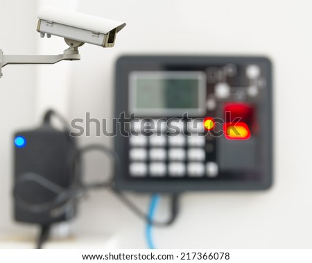 Security camera monitoring the finger print scan machine blurred photo - stock photo