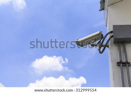 Security camera on blue sky background