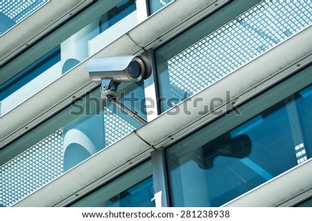 security camera on modern building  - stock photo