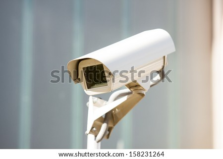 Security camera on the sky background - stock photo