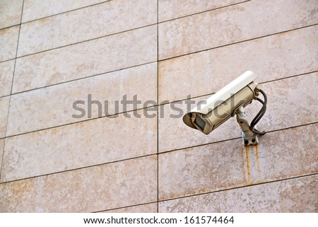 Security camera on the wall. Private property protection.