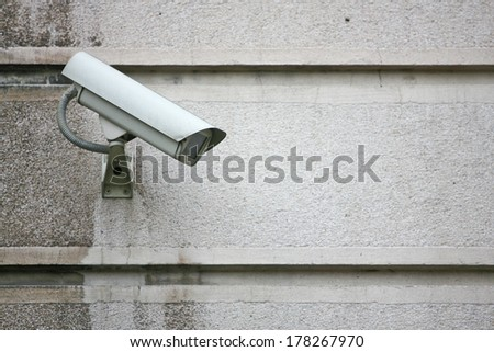Security Camera on the wall, Private property protection - stock photo