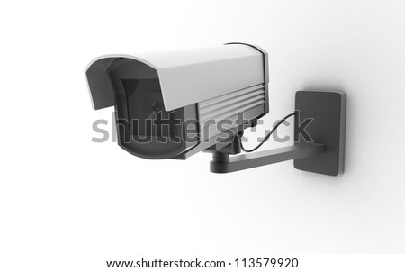security camera on wall - stock photo