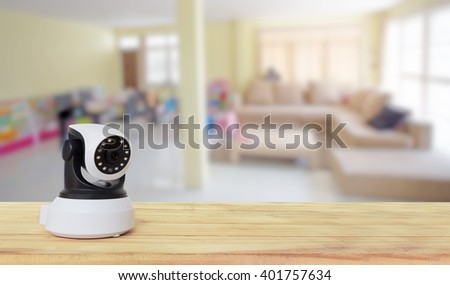 Security camera on Wood table. IP Camera. - stock photo