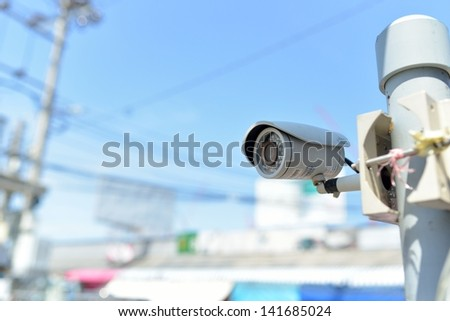 Security Camera or CCTV on blue sky - stock photo