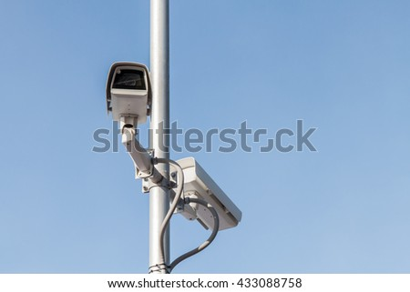 Security camera or cctv  on blue sky background