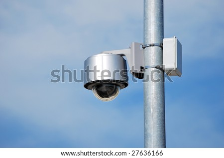 Security camera placed in a metallic row. Security concept - stock photo