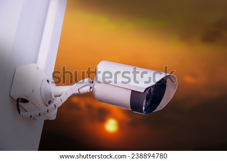 Security cameras for the safety and sunset background - stock photo