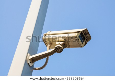 Security cameras or CCTV against blue sky