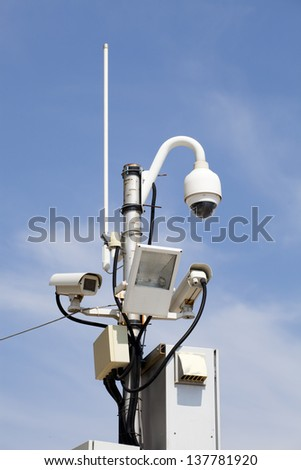 security cameras over the blue sky
