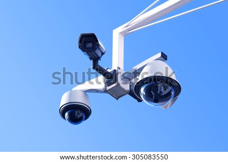security cameras - the all-seeing eyes - stock photo