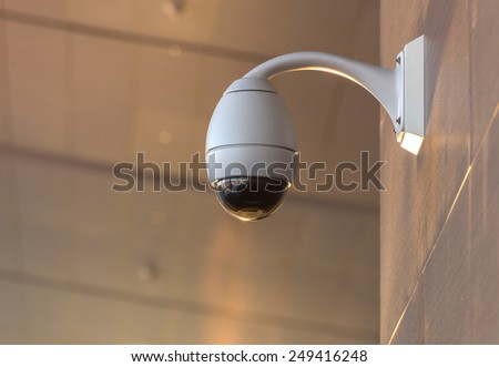 Security CCTV camera and urban video. - stock photo