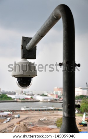Security CCTV camera for monitors construction site area. - stock photo