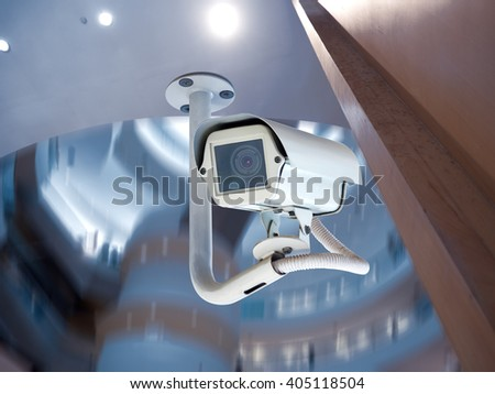 Security CCTV camera or surveillance system in modern office building - stock photo