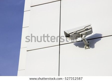 Security CCTV camera surveillance system on the wall modern office building