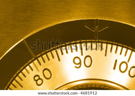 Security ~ combination safe lock, in golden tone. - stock photo