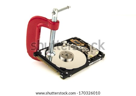 security concept, hard drive in a clamp - stock photo
