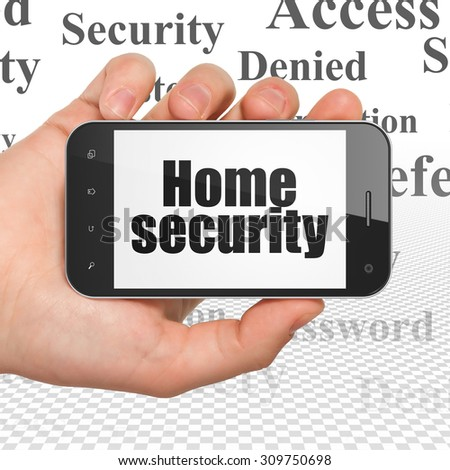 Security concept: Home Security on Hand Holding Smartphone display - stock photo