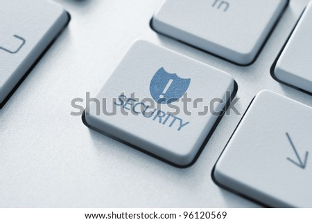 Security concept key on the keyboard. Toned Image. - stock photo